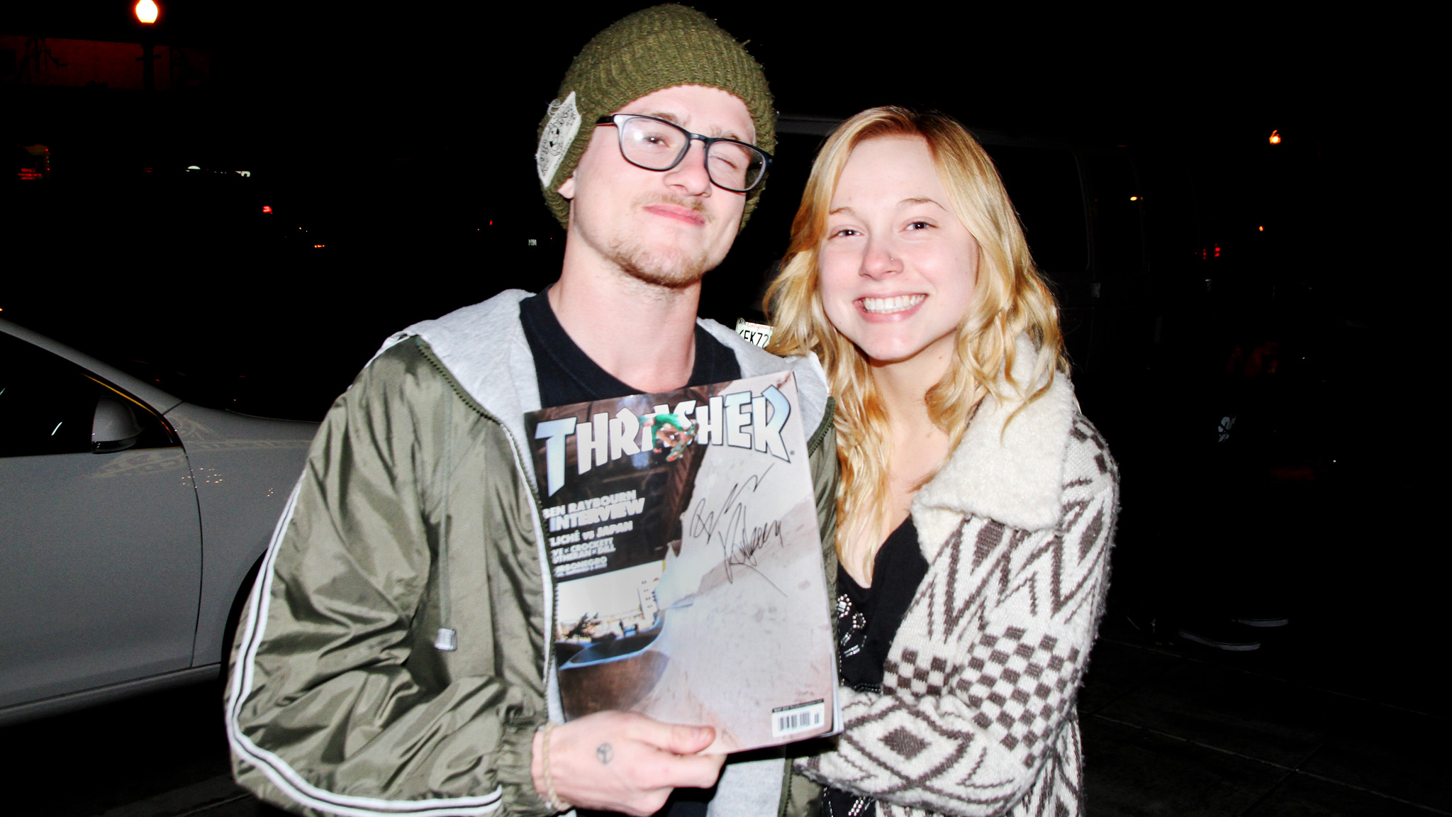 Ben Raybourn and friend show off his Thrasher cover during the New Ground premiere.
