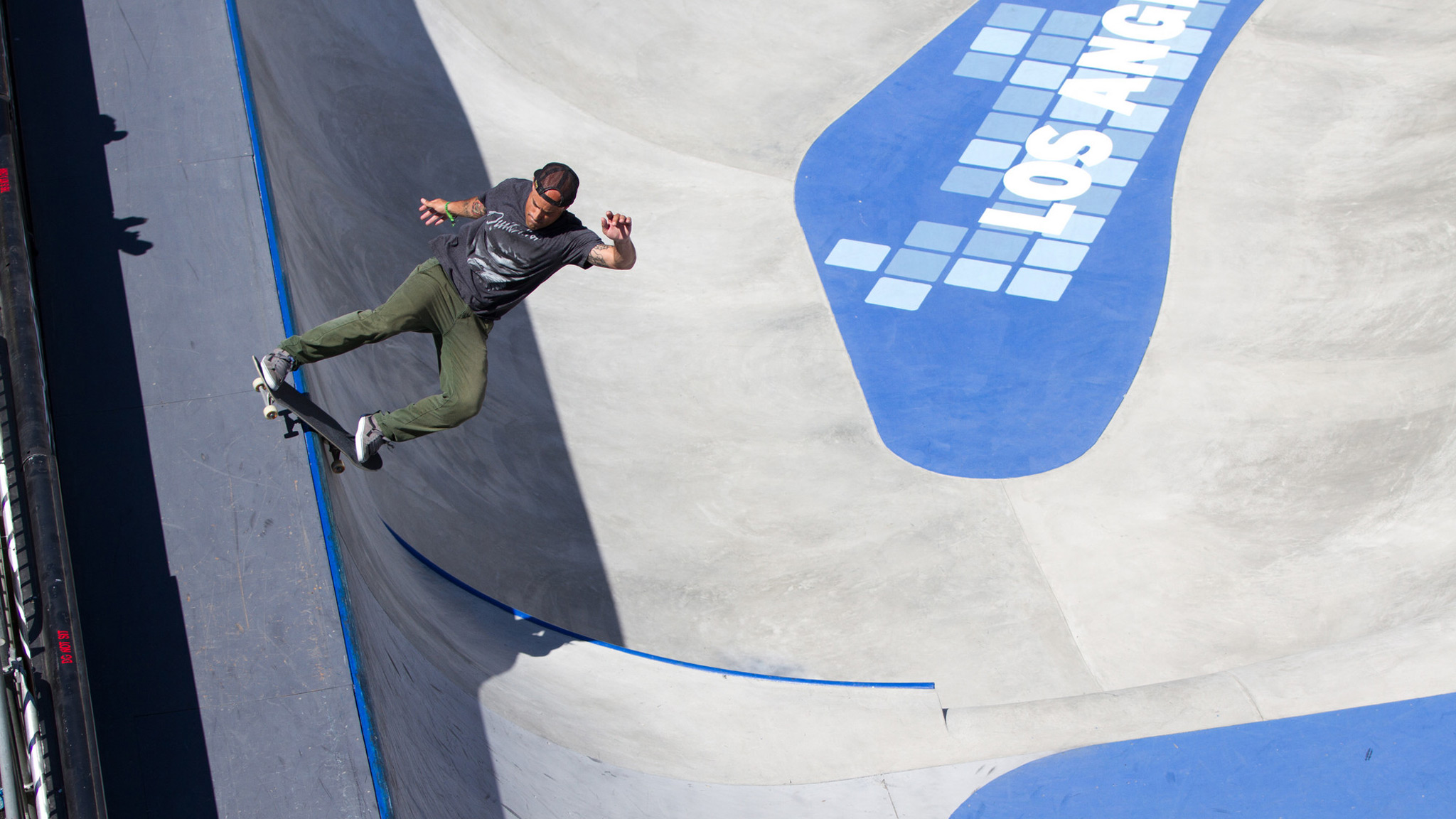 Omar Hassan lipslides the flat wall in Skateboard Park during X Games Los Angeles 2012. California Ramp Works built the Park and Street courses and the Big Air ramp.