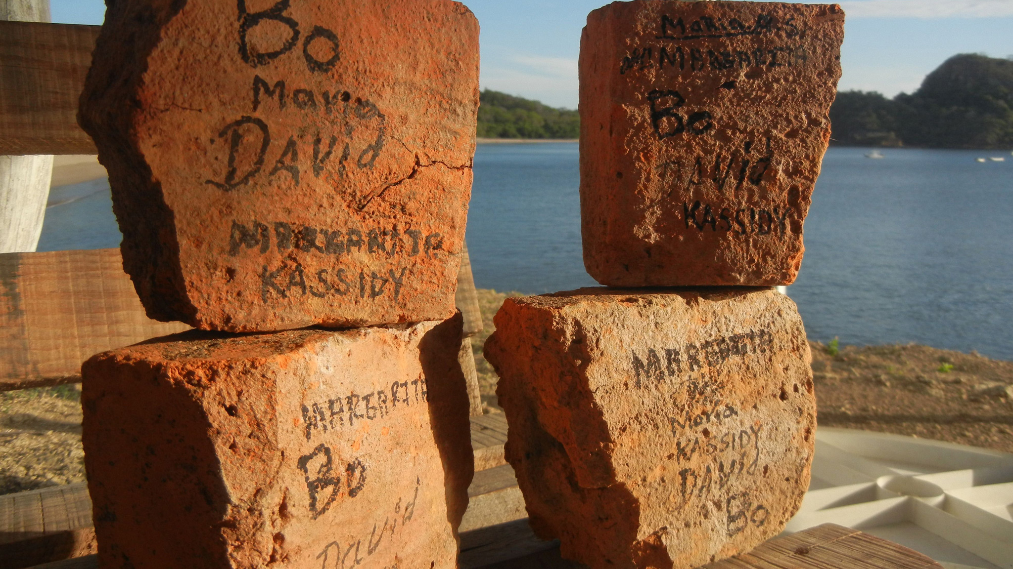 The first bricks of the community health center to be built in Gigante, Nicaragua, signed by the Gigante Health Committee.