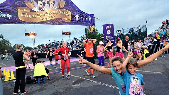 Summer Sanders and her son ran Sunday at the Disney Parks in Orlando.