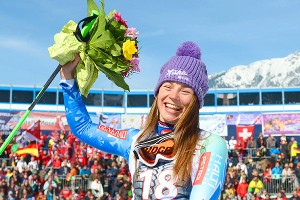Tina Maze continued her dominant season Saturday, breaking the record for points in a World Cup season by winning a downhill event in Germany.