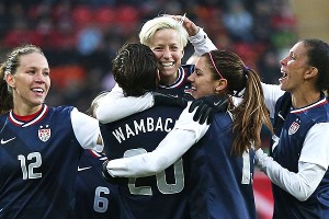 The U.S. celebrates after Abby Wambach scored the team's first goal Friday in Germany.