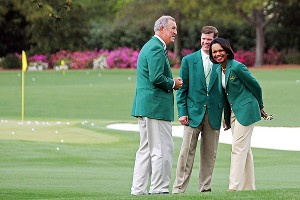 Condoleezza Rice (right) played a practice round with Phil Mickelson at Augusta National on Sunday.