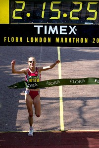 Paula Radcliffe crossed the 2003 London Marathon finish line in 2:15.25 to break her own world record.