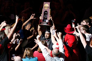 Peyton Siva carries the national title trophy during Wednesday's championship celebration.