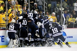 Andrew Miller scored in overtime to lift Yale to a 3-2 victory in the NCAA men's hockey semifinals Thursday night.