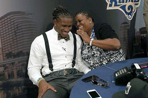 Wide receiver Cordarrelle Patterson is embraced by his mother after being picked by the Vikings.