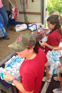 Sooners softball players help out with the relief effort after the tornado.