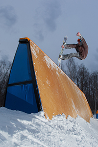 Sugarbush rider Jeff Deforge jams into a stalefish front board on one of the park's many features.