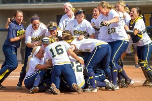 Michigan players piled on after getting the final out Saturday.