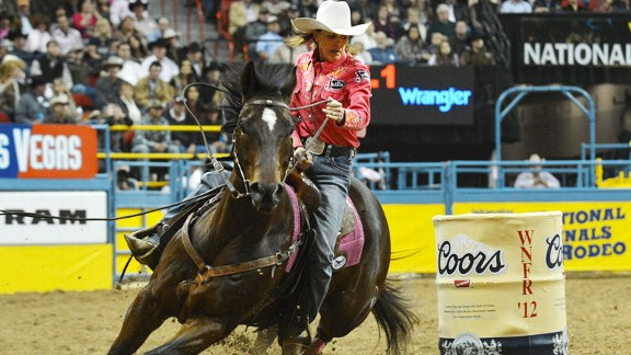 Mary Walker rounds a barrel on Latte, the horse who fell on her causing catastrophic injuries in 2011, during the 2012 WNFR where Walker won her first world title.