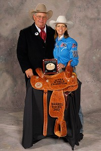 Byron and Mary Walker pose with Mary's world champion buckle and saddle, won at the 2012 Wrangler National Finals Rodeo in Las Vegas.