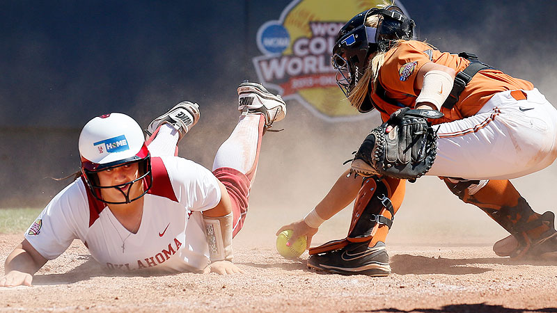 Oklahoma's Brittany Williams reaches back to make sure she touched home plate during in front of Texas catcher Mandy Ogle during the Sooners' six-run third inning.