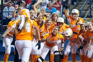 Madison Shipman is greeted at the plate after her homer in the 11th gave the Lady Vols a 3-0 lead.