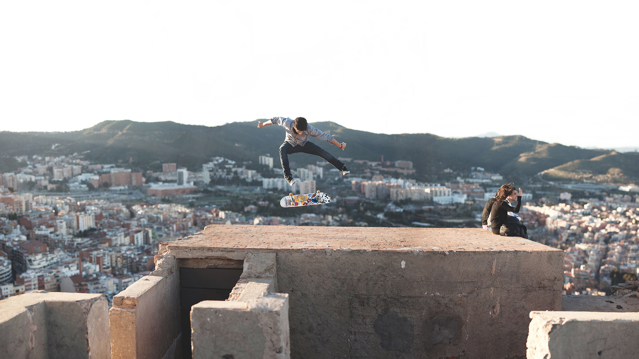 This was taken in Barcelona. I really liked the super-strong composition, but also there are a bunch of tourists completely oblivious to what's going on behind them. It's also on this kind of non-skateable surface, on this rough-looking bunker. This captures very much an instant. -- Alex Hillinger