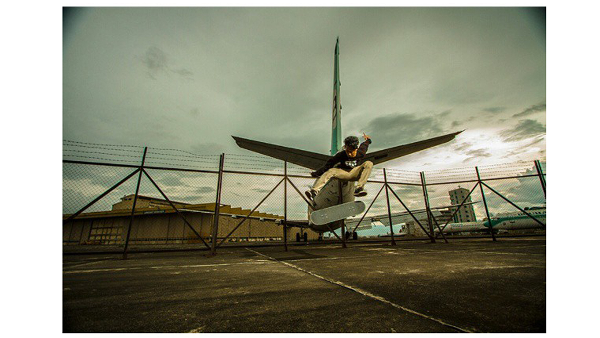 It's an awesome composition overall. It's really kind of got this almost Eastern European feeling in the background with the barbed wire and the plane and the way that the photo has juxtaposed the skater against the plane. The caption was really cool: 'Fly like a plane.' -- Alex Hillinger