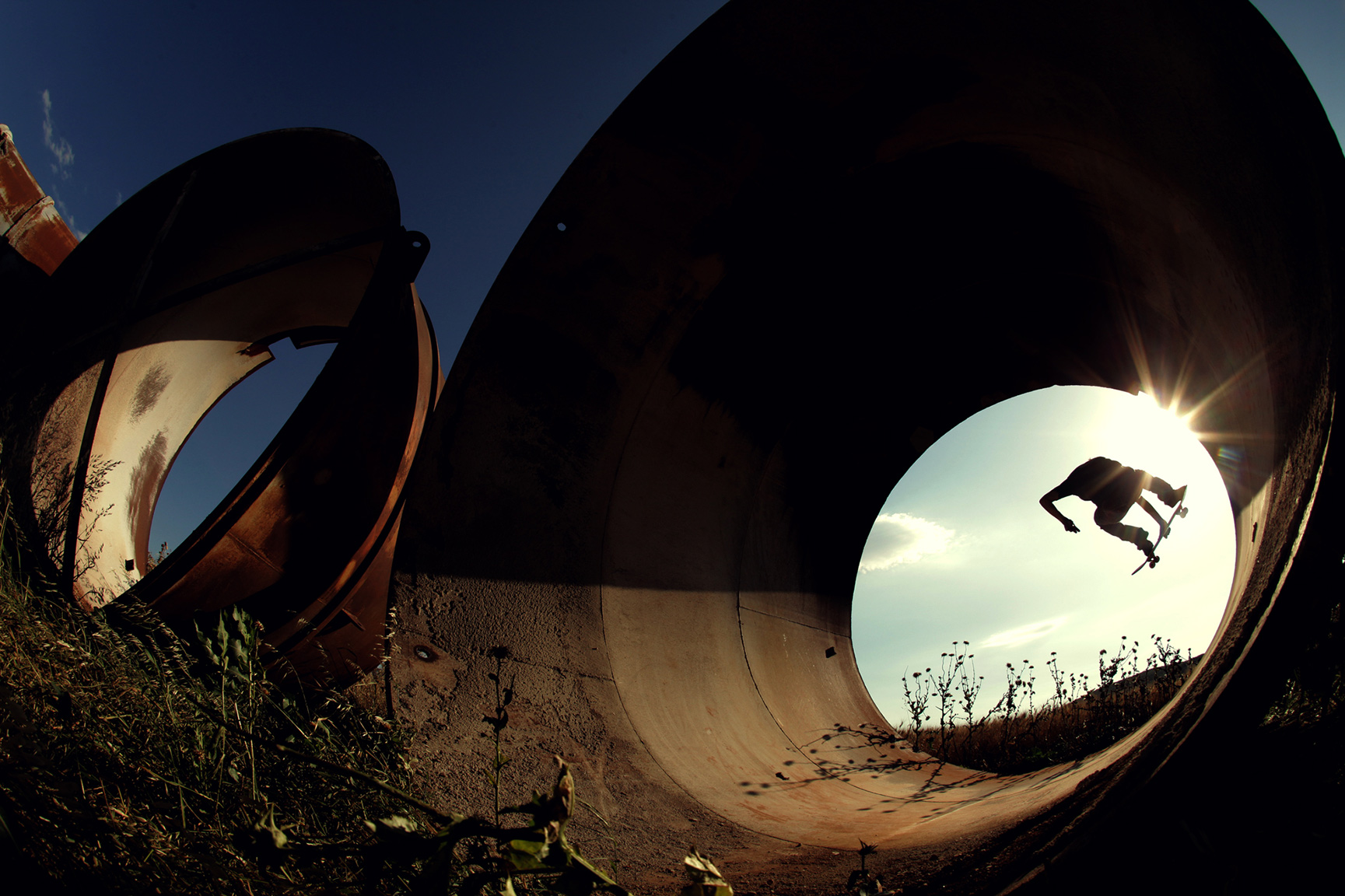 Chris Loupis, frontside 180, Thiva, Greece. This photo's got some really cool kind of fisheye effect. It's got the light -- the way the sun flare is coming through the edge of the pipe is really cool. There's nothing glam about it at all. It's core. -- Alex Hillinger
