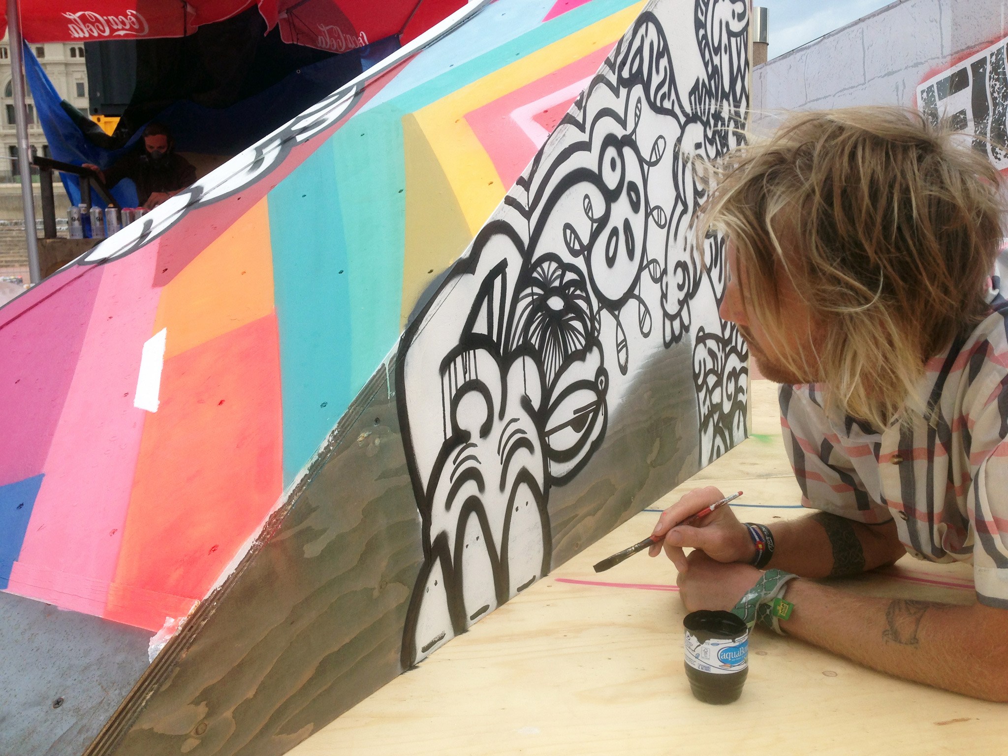 So-Gnar co-founder Pat Milbery puts the finishing touches on his X Games Barcelona art with some brush strokes.