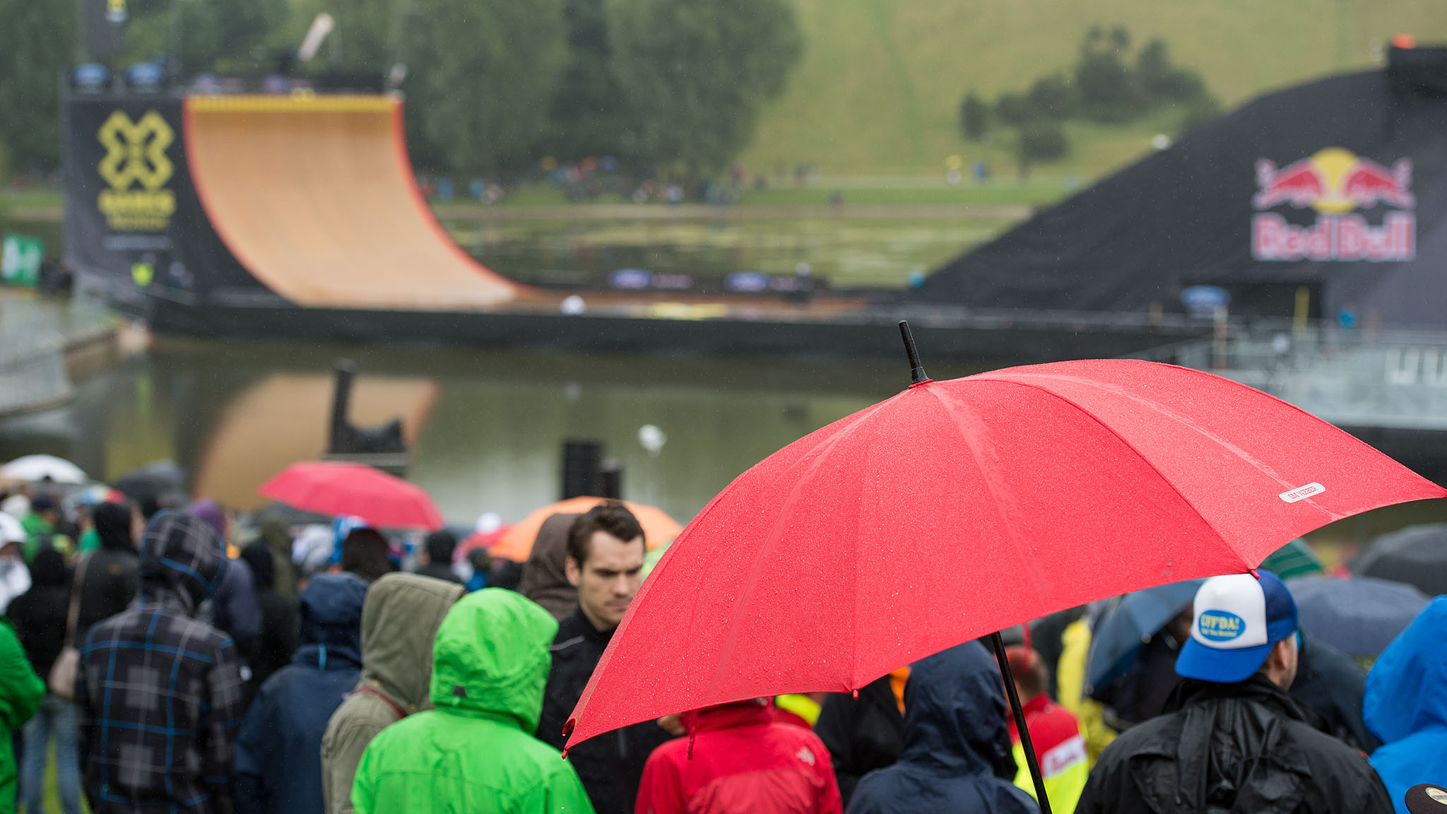 Spectators wait for the start of Skateboard Big Air near the MegaRamp at X Games Munich. Rain and inclement weather forced organizers to postpone the event until Sunday, June 30, setting up an action-packed day for spectators that will also include the finals in Enduro X, Mountain Bike Slopestyle and Street League as well as a RallyCross race.