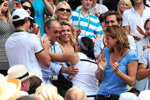 Marion Bartoli climbed through the stands to get a hug from dad Walter during her championship moment.