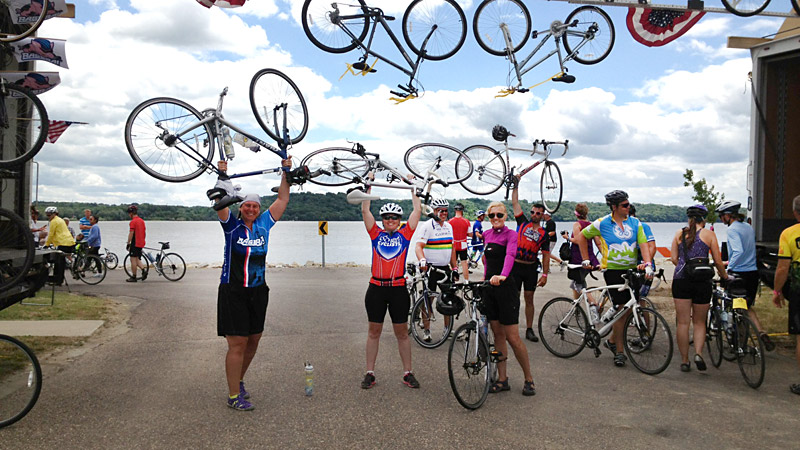 Heather Burns, center, celebrates at the RAGBRAI finish line after completing her 405-mile journey across Iowa.