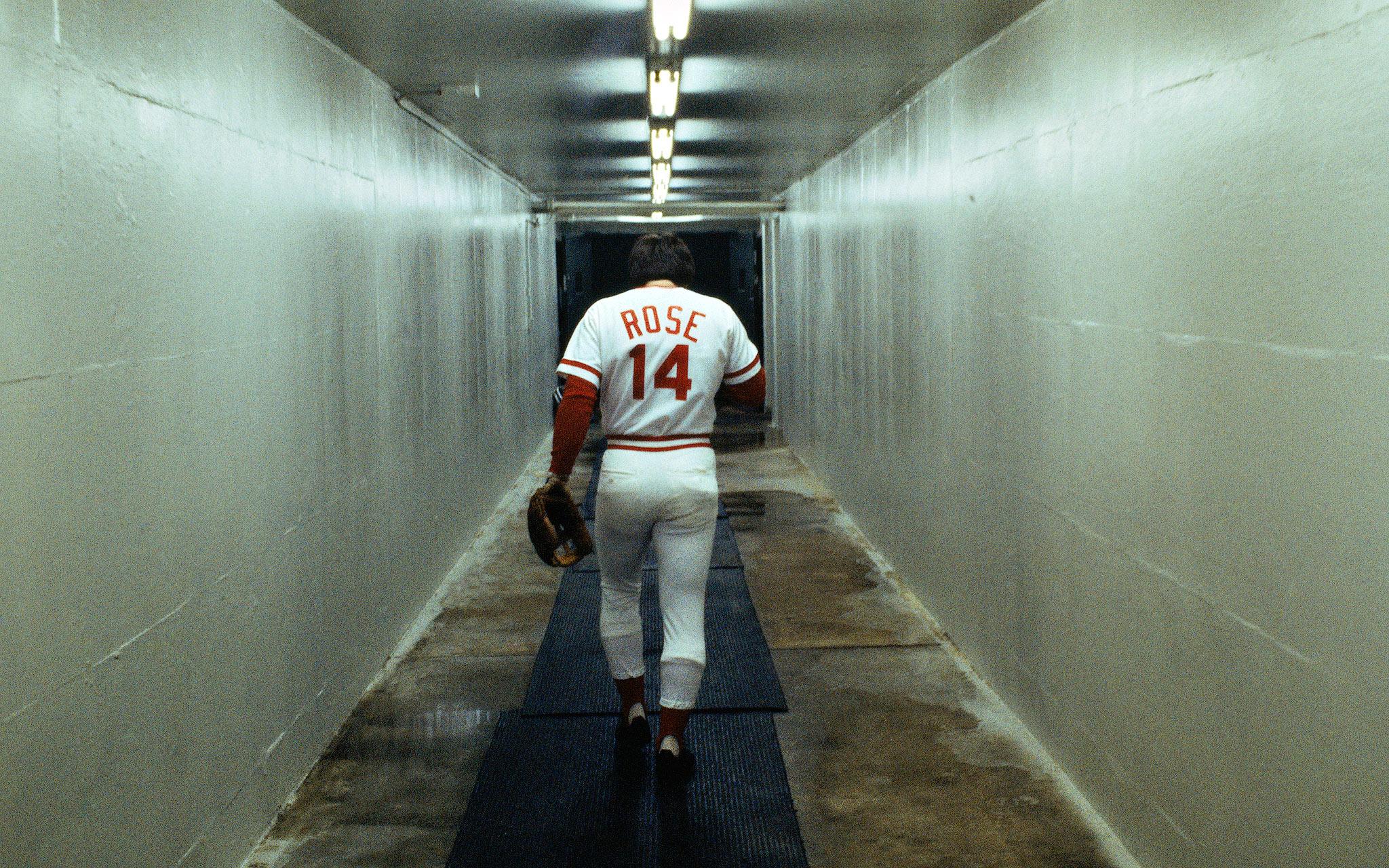 CINCINNATI - UNDATED: Outfielder Pete Rose #14 of the Cincinnati Reds walks alone down a vacant corridor at Riverfront Stadium during the 1970s in Cincinnati, Ohio.