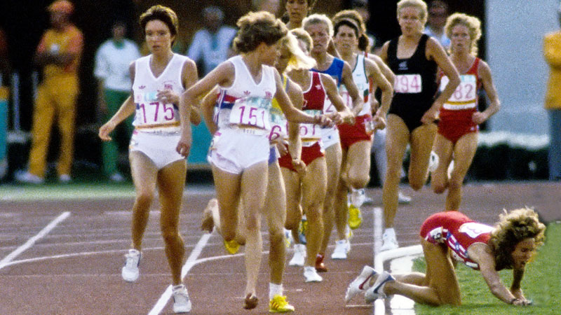 Zola Budd turns toward Mary Decker after the American fell off course during the 3,000-meter final at the 1984 Summer Olympics.