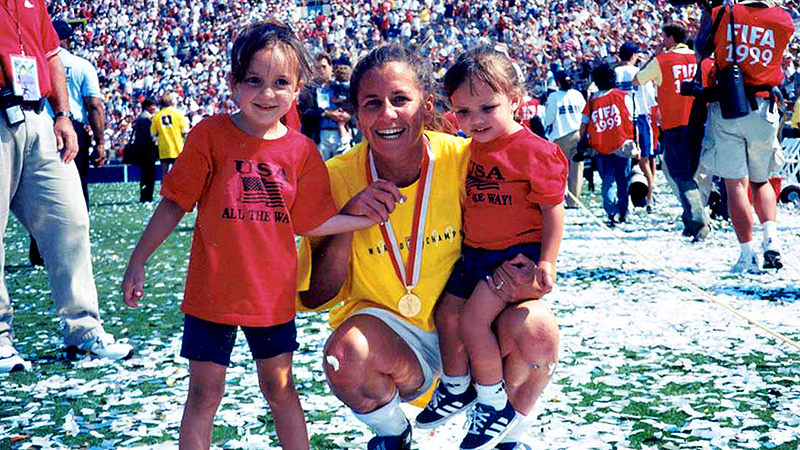 Joy Fawcett celebrates her 1999 Women's World Cup win with daughters Katey, left, and Carli.