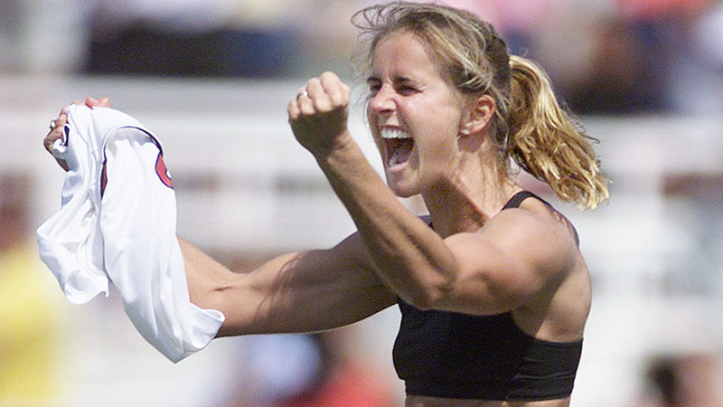 On July 10, 1999, the U.S. women's soccer team faced China in the Women's World Cup championship game. In front of a sold-out crowd of over 90,000 at the Rose Bowl in Pasadena, Calif. -- the largest crowd ever to attend a a women's sporting event -- the game was tied at zero at the end of regulation and remained scoreless through two overtime periods. A dramatic save by goalkeeper Briana Scurry during the penalty-kick shootout and a goal by Brandi Chastain (pictured) lifted the U.S. to the victory. Chastain's victory celebration, in which she took off her jersey and exposed her sports bra, instantly became an iconic and somewhat controversial moment seen on newspaper and magazine covers around the world. Sports Illustrated named the entire team their Sportspeople of the Year, and soccer saw an immediate rise in popularity in America.