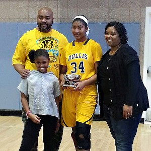 Wynard and Lynett Belton are now both on board with Lynee's basketball pursuits. Kid sister Nyla, though, still prefers swimming and soccer.