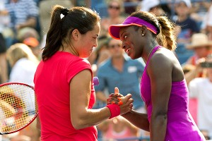 Jamie Hampton, left, and Sloane Stephens meet at the net after their match Friday. Hampton said she has a tendency to play really bad in big moments.