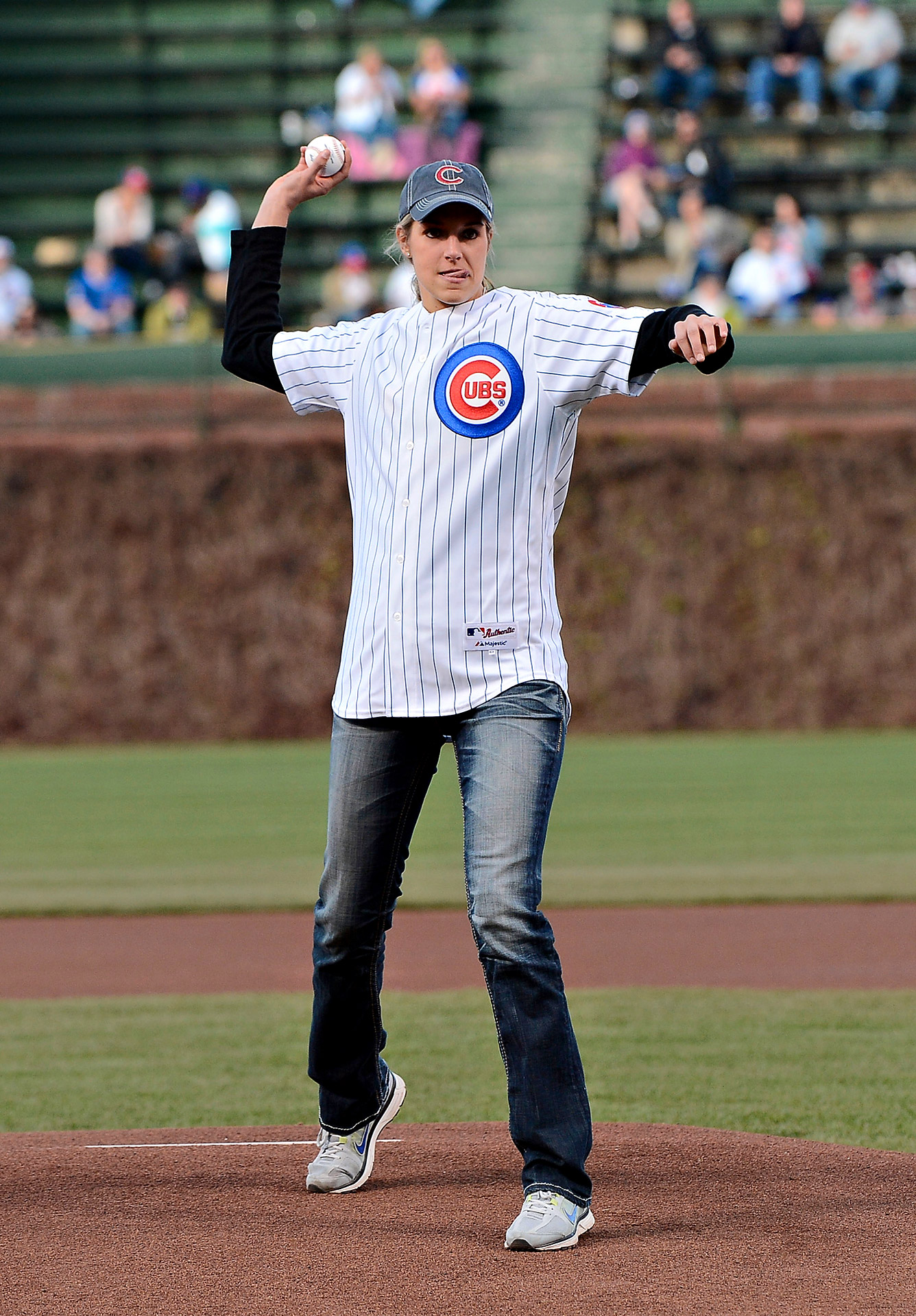 Elena Delle Donne has settled right into Chicago and, after throwing the first pitch at a Cubs game on one of her first nights in her new hometown, she named her Great Dane Wrigley.