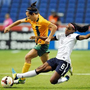 Crystal Dunn, right, a senior at North Carolina, met the challenge of defending  Australia forward Lisa De Vanna.