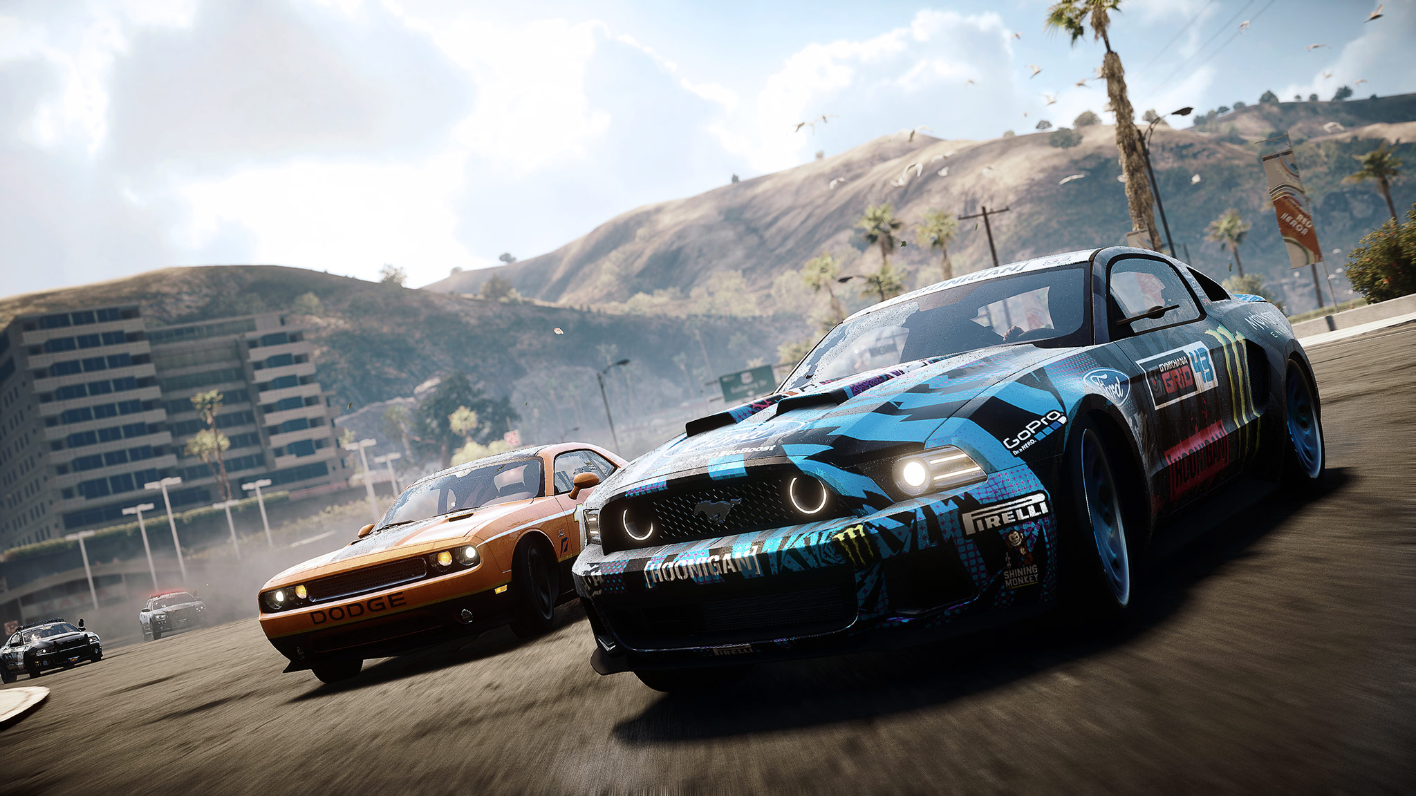 This image, taken from the latest Need For Speed video, shows the Ken Block Ford Mustang from the new game power drifting a corner.