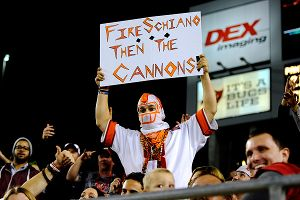 A Buccaneers fan holds up a Fire Schiano sign