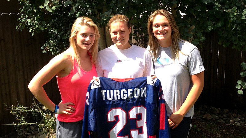 Lyndsey Fry, middle, has stayed in touch with the Turgeon family --  including sisters Valerie, left, and Alex, right -- as she chases her Olympic dream, and she's held  Liz Turgeon's jersey every step of the way.