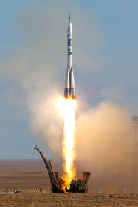 A Soyuz rocket launched the Olympic flame into space Thursday ahead of the 2014 Winter Games.