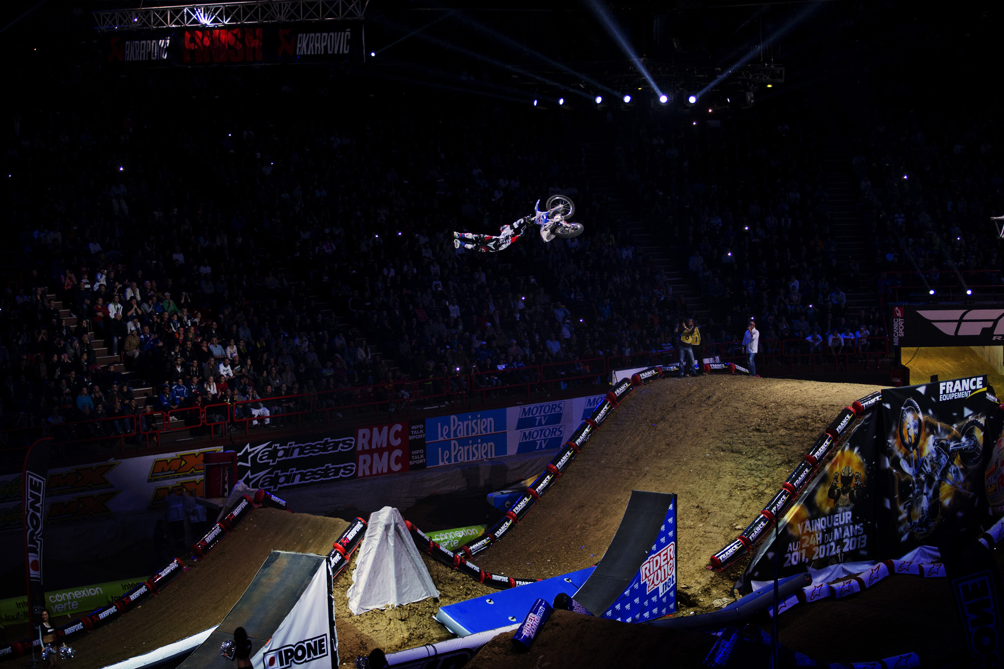 Thomas Pags gets full extension on this air in front of his home-country fans in Paris at the Bercy Supercross.