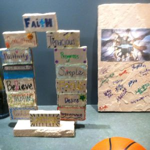 Each Colorado player created a brick with an inspirational word, and the coach built the bricks into an arch.