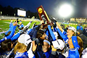 UCLA holds up the NCAA Championship trophy after deteating Florida State 1-0 in overtime on Sunday.