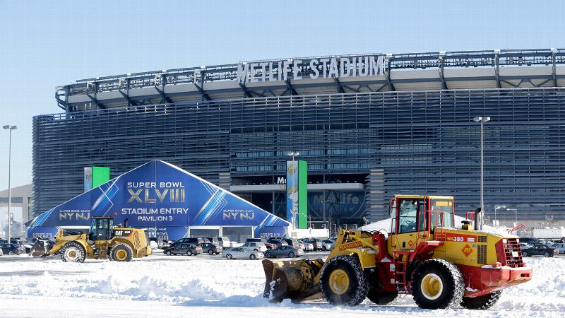 Snow in the Meadowlands doesn't stand a chance against the NFL's army of machines.