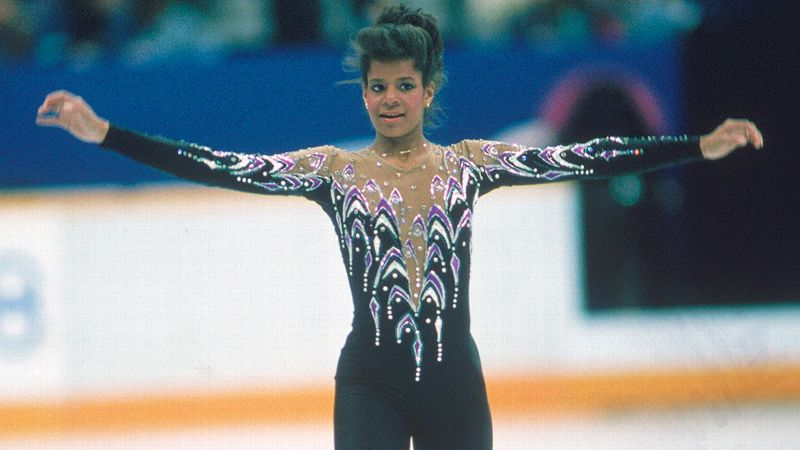 After winning the U.S. and world titles in 1986, all eyes were on Debi Thomas at the 1988 Olympics. It didn't hurt that her rivalry with East German Katarina Witt was amplified when both chose to skate their long programs to Bizet's Carmen. Although it was Witt who struck gold, Thomas became the first African-American to win a medal at the Winter Olympics when she took home the bronze. i (Photo:  Focus on Sport/Getty Images) /i