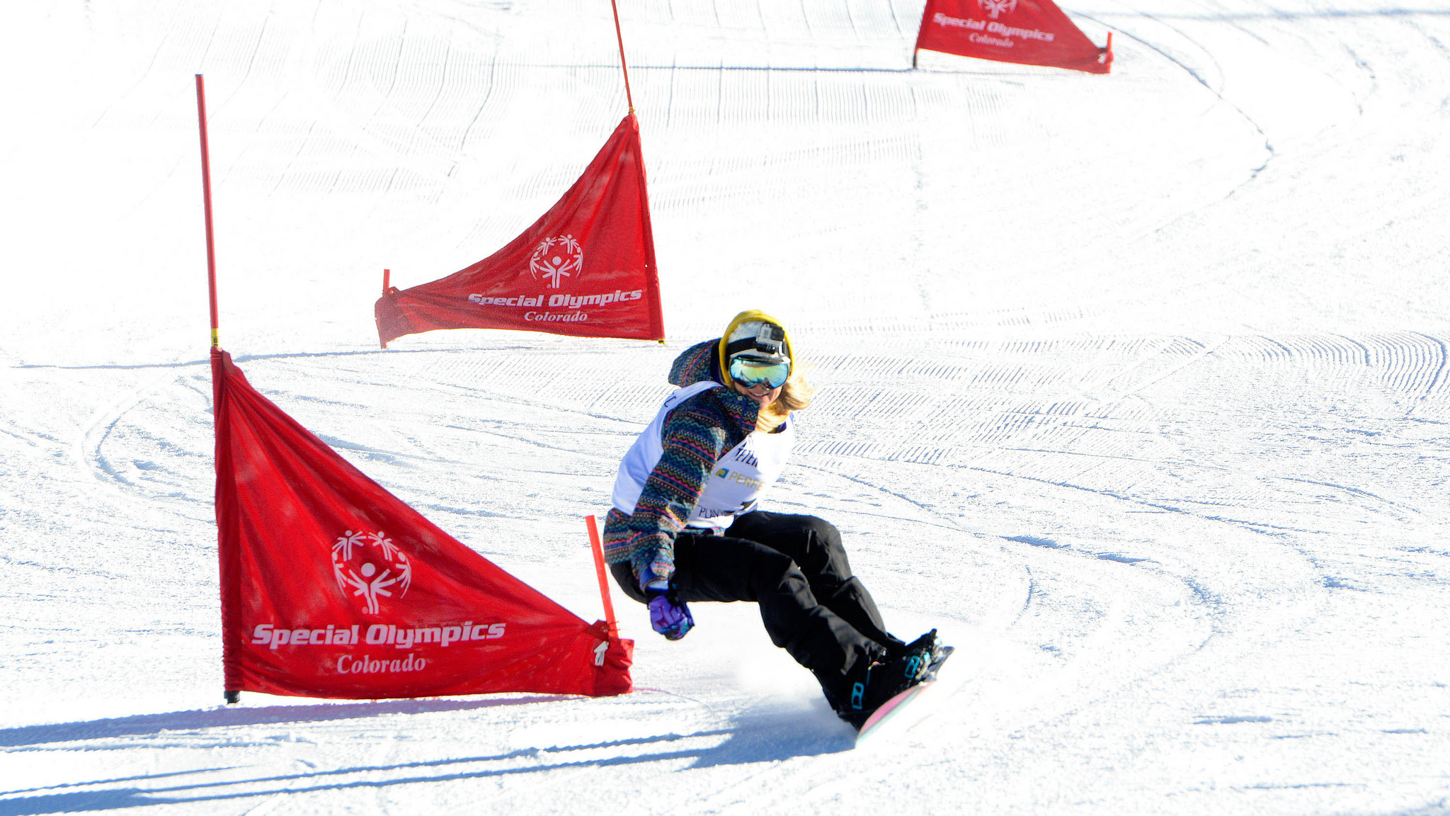 Olympic athlete and Special Olympics Global Ambassador Hannah Teter heads down Aspen Mountain during the unified dual slalom races in Aspen, Colo.