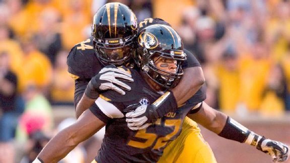 Missouri teammates, such as defensive lineman Sheldon Richardson here, celebrated Michael Sam's play on the field.