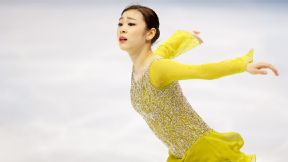 Kim Yu-Na holds a slight lead after the women's short program in Sochi.