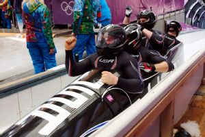 Steven Holcomb won his third medal Sunday as the U.S. won bronze in the four-man bobsled, which tied him for the most by any U.S. bobsledder.