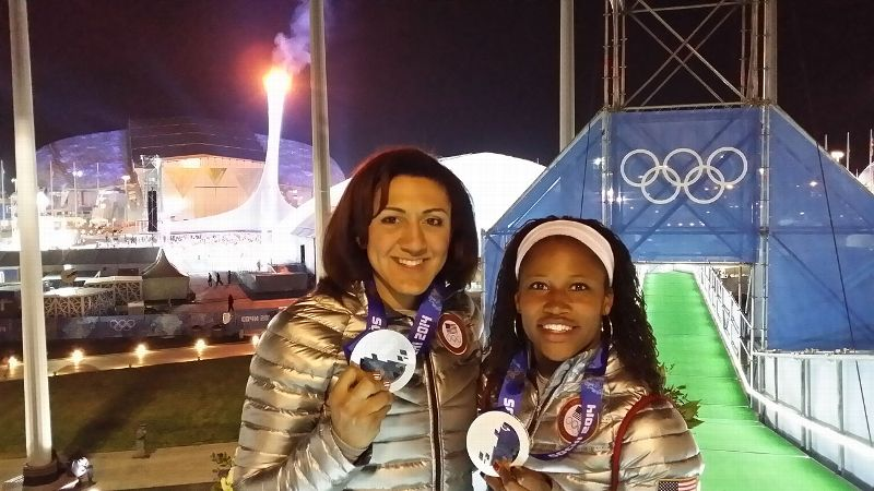 Elana Meyers (left) and Lauryn Williams made history with their silver medal in bobsled. Meyers became the first American woman to win two bobsled medals, while Williams became the first to medal in both the Summer and Winter Olympics.