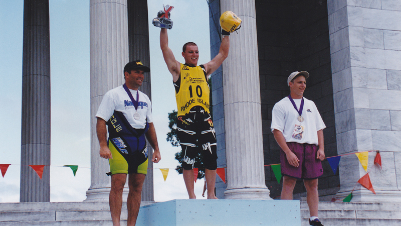 Justin Seers receives the very first gold medal of ESPN's Extreme Games, alongside silver and bronze medalists Ron Scarpa and Rael Nurick.