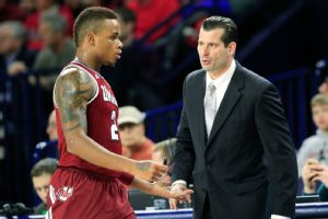 UMass coach Derek Kellogg says Derrick Gordon's decision to come out has brought the team closer.