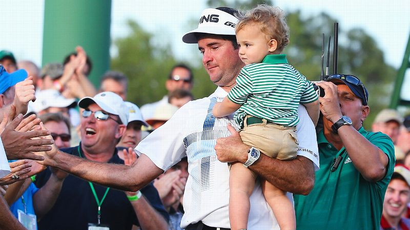 Bubba Watson takes his son, Caleb, along for the high-five ride after winning the Masters for the second time.
